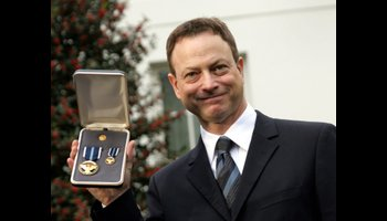 Sinise with his medal