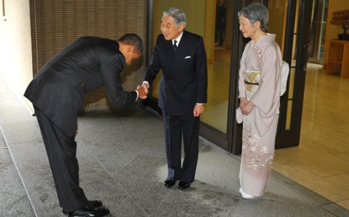 Obama bowing to Japanese Emperor